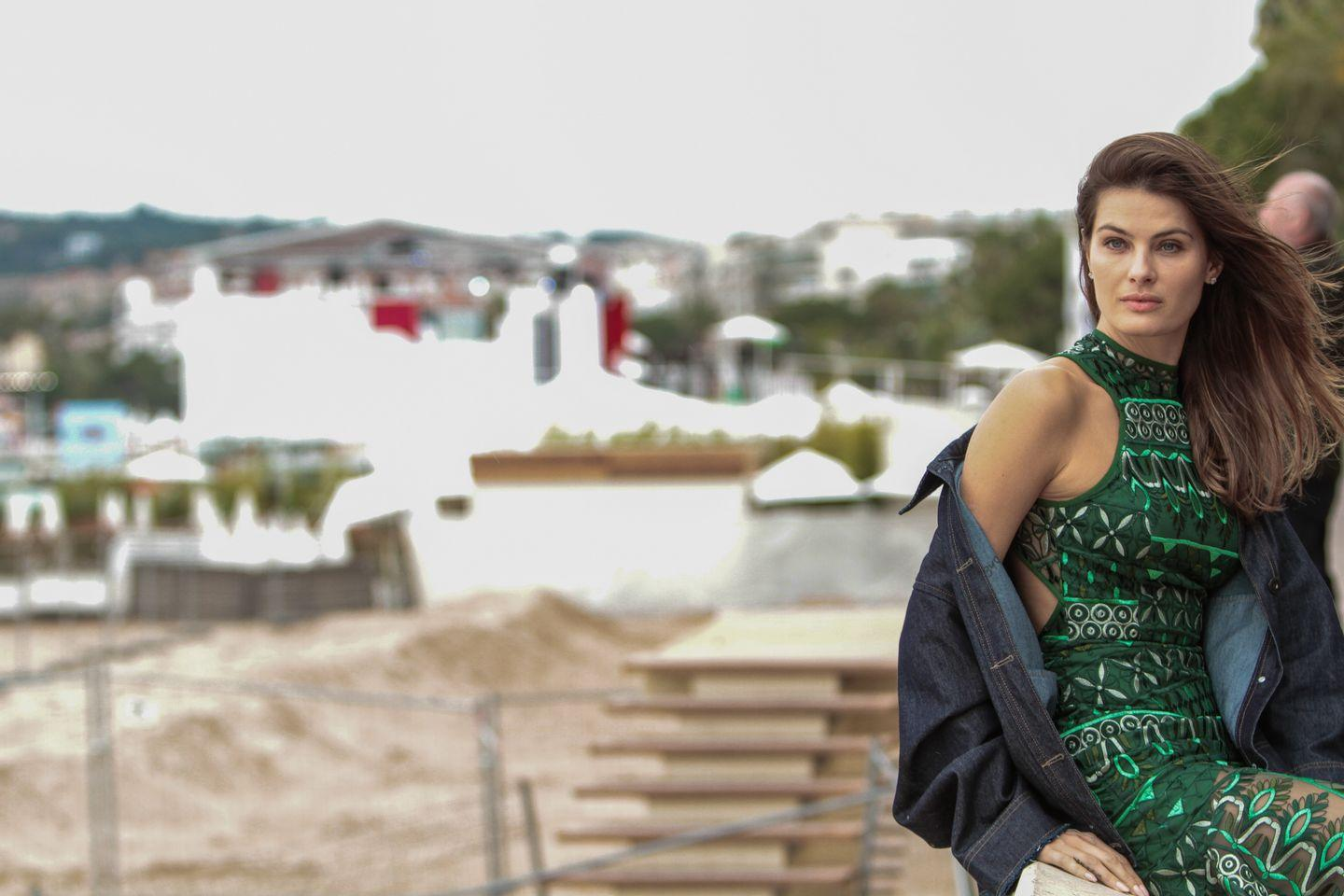 Izabel Fontana spotted during a photo shoot with a green dress