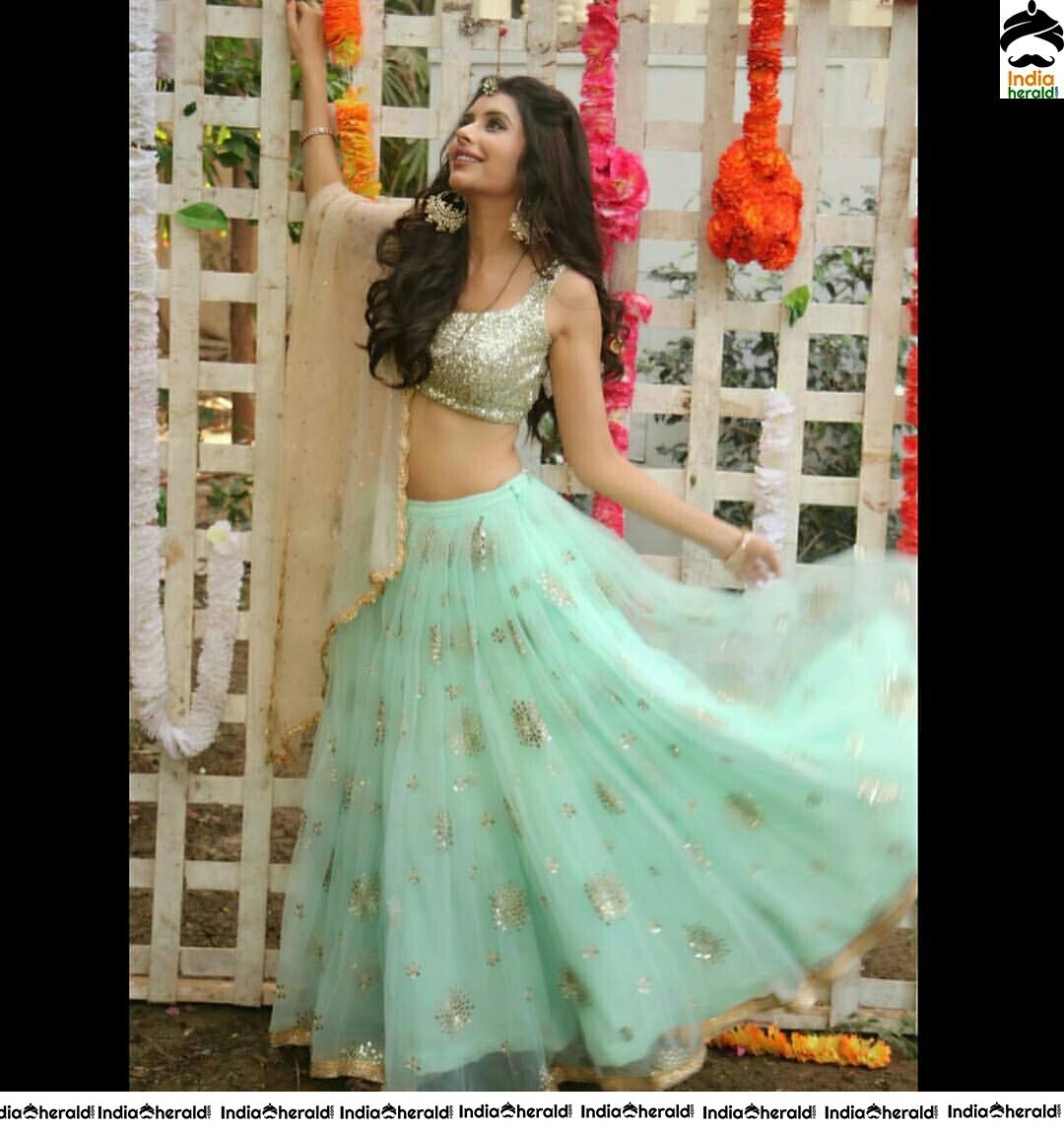 Charu Asopasen Put Sandal with Green Colour Choli