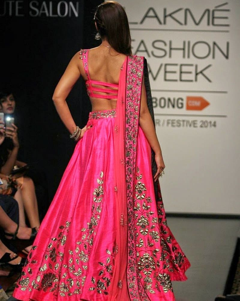 Ileana Walks The Ramp In A Waist Revealing Dress