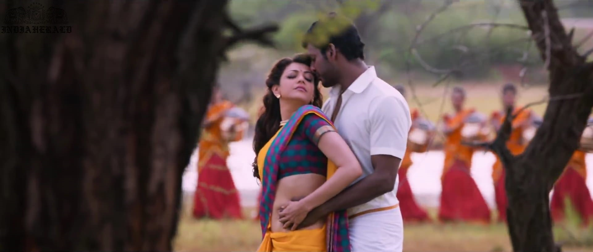 Kajal Aggarwal waist squeezed and Navel pressed by Hero Hot photos Set 1