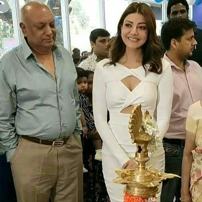 Kajal Aggerwal With Her Dad At The Opening Of Ratnadeep Showroom