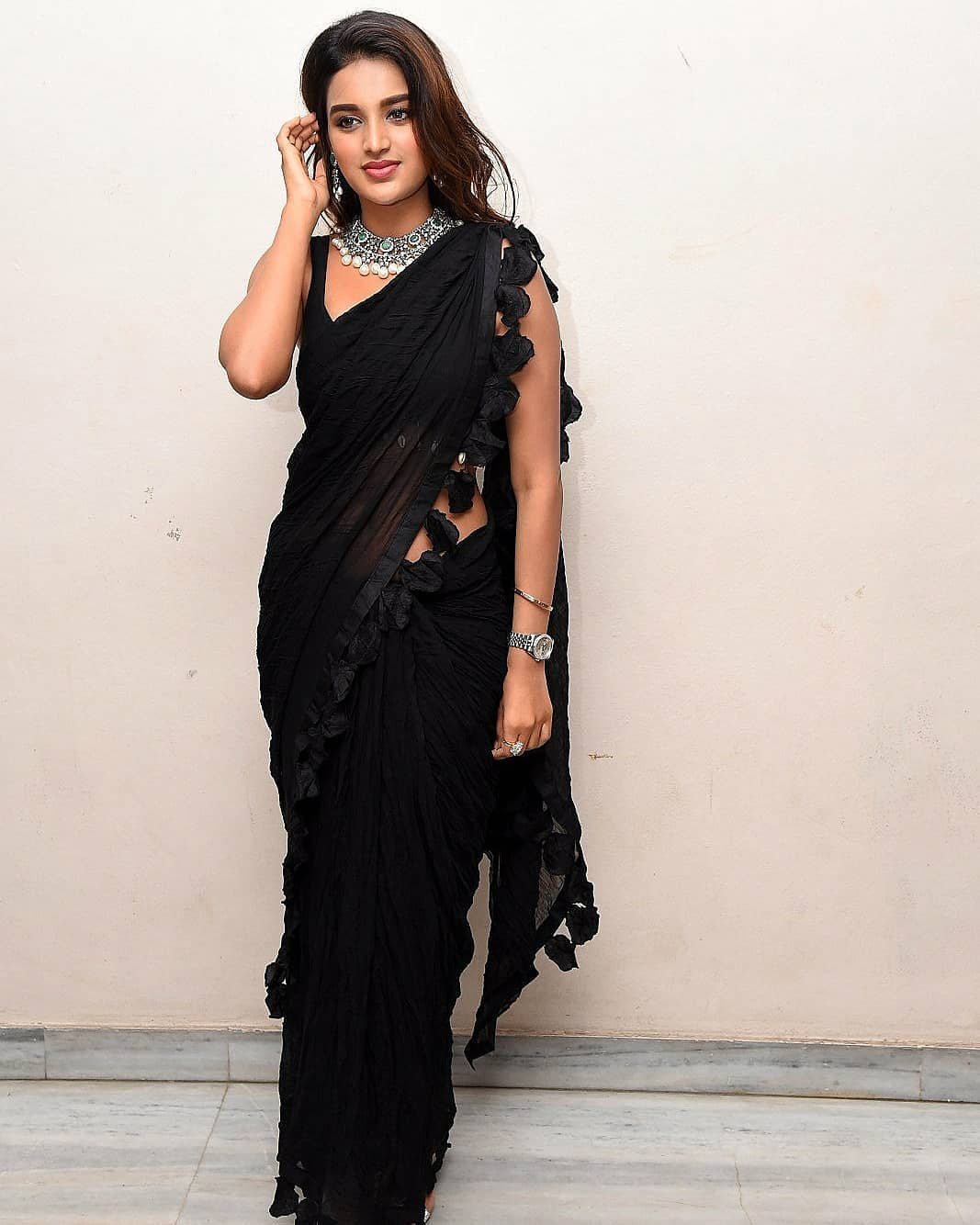 Niddhi Agerwal Showing Her Sexy Waist InTransparent Black Saree