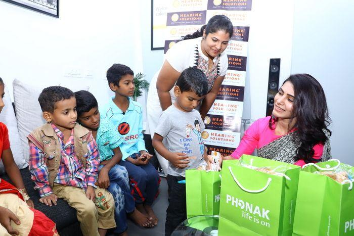 Samantha at an event for hearing-impaired kids