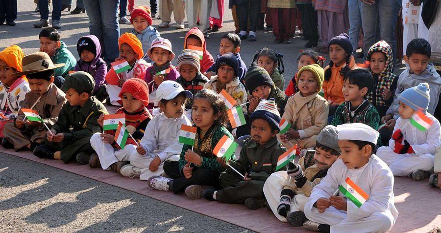 report writing celebrating republic day school children in school
