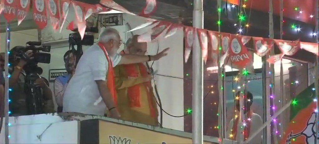Modi waves at BJP supporters outside the party office in Ahmedabad
