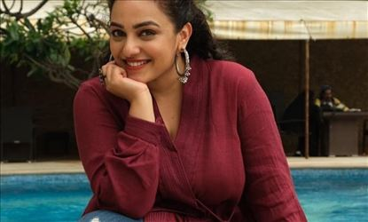 Nithya Menon Oozing Hotness In A Maroon Tight Dress