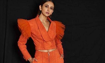 Rakul Preet Hot In Orange Photo Shoot