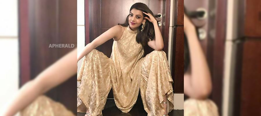 Whoaa... Kajal posing in a Sexy and 'Inviting' way for her Latest Photoshoot in a sleeveless dress - HOT PHOTOS INSIDE