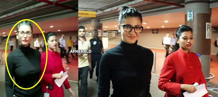 Ooopp... Yess... This is our SHRUTI HAASAN in BLACK at AIRPORT... CAUGHT RED-HANDED - PHOTOS INSIDE