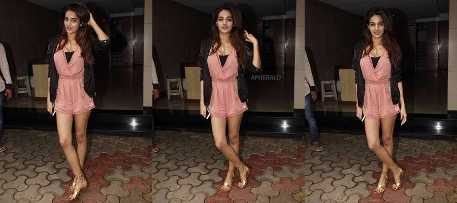 Nidhi Agerwal in a Short Thigh-High Sexy Frock exposing her beauty before cameras - HOT PHOTOS INSIDE
