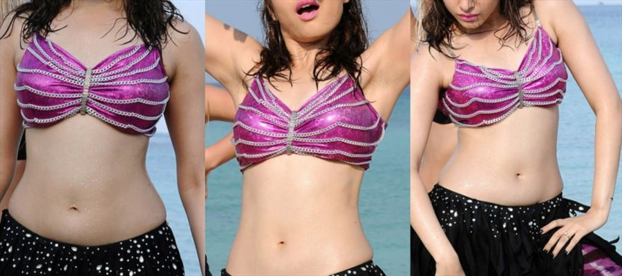 16 Very HD Photos of Tamanna getting WET and HOT in Beach