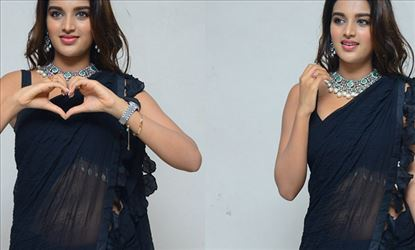 Nidhhi Agerwal tempts your mood in this Sleeveless Transparent Saree exposing her Hot Assets - 25 Hot Photos Inside