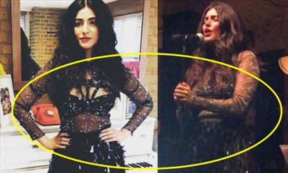 Shruti Haasan sang on stage wearing a Black Transparent outfit - Photos Inside