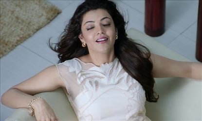 Kajal Aggarwal shows her Hot Figure in this UNSEEN Condoms Ad !?! - View Pics