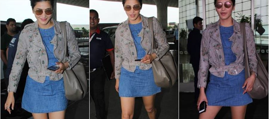Shruti Haasan once again wears a Short Denim Frock and grabs everyone's eyeballs in the Airport