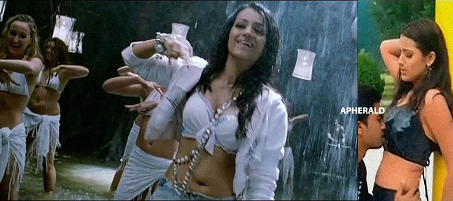 Even at 36 years, Trisha is still Smokin' HOT and does Sexy Roles - These Photos PROVE IT.. Check it out...
