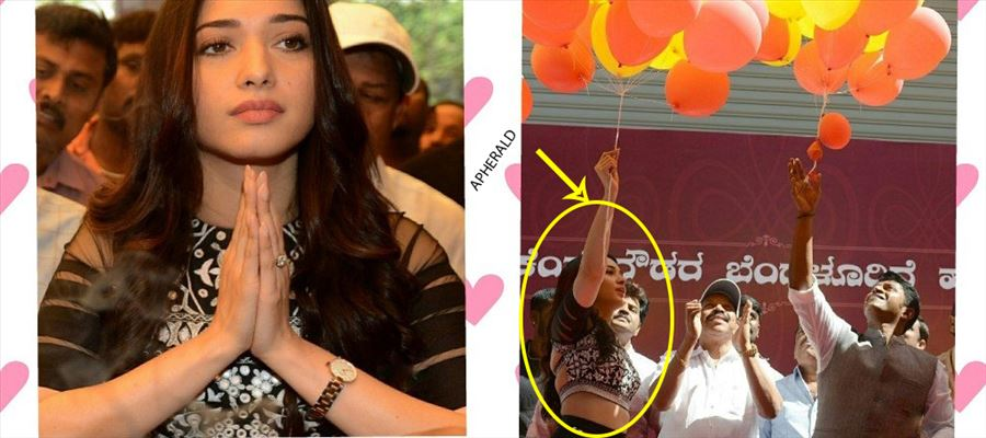 The whole Crowd goes 'GaGa' as Tamanna shows her Waist while leaving Balloons at Showroom Inauguration - View Pics!