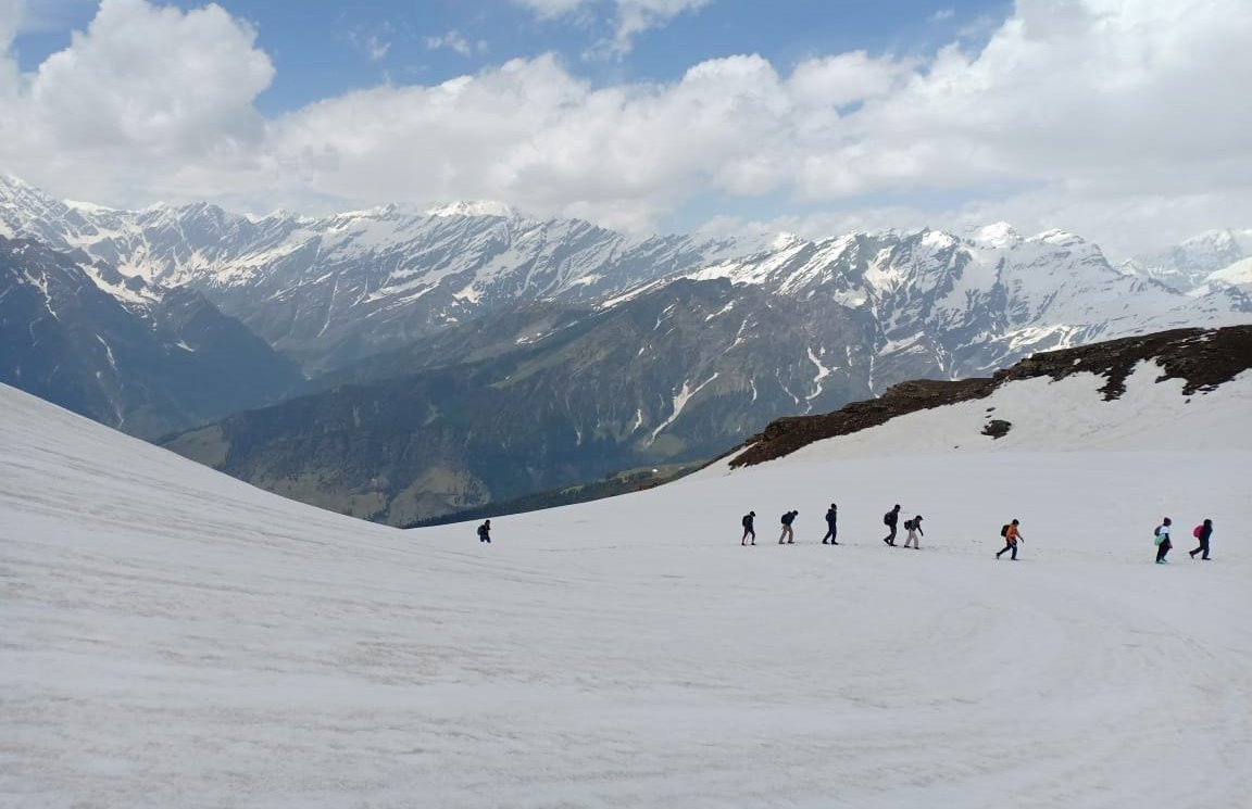 Tourists Enjoy Snow Clad Mountains Near The Frozen Bhrigu Lake