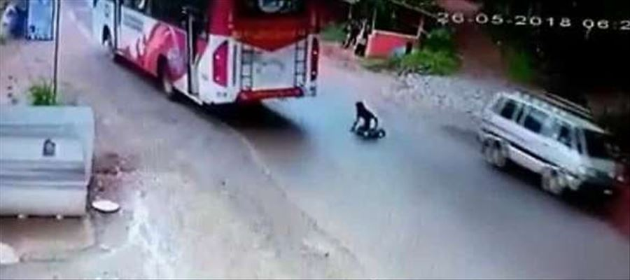 A close escape for a biker - Caught on CCTV