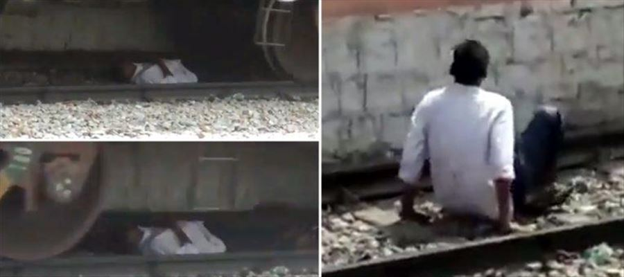 Andhra Man found under Moving Train, Escaped miraculously  Watch this VIDEO!