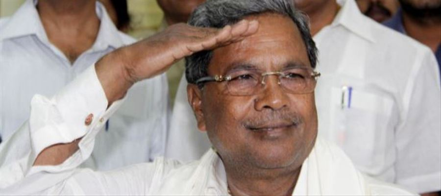 Is there any provision in the constitution that prohibits a state from having a flag?? Questions Karnataka CM