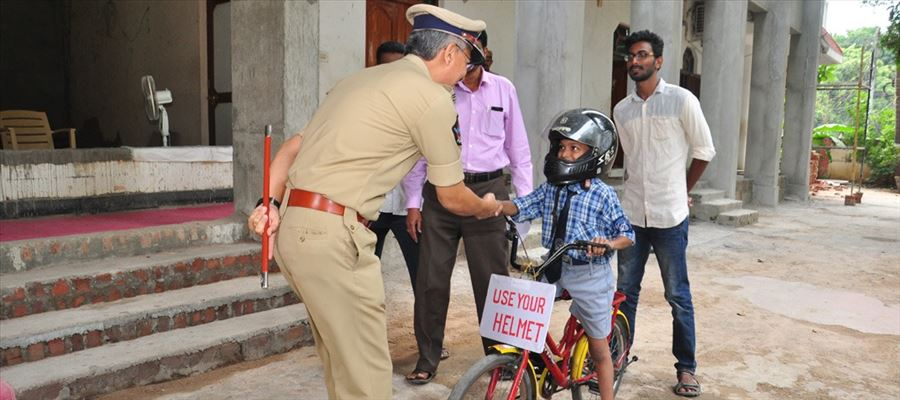 Here's Andhra's 'Helmet Boy' - The Little Warrior who saves lives!
