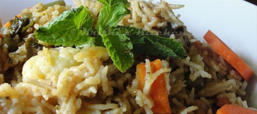 How to make Veg Biryani - Biryani made with vegetables, brown poha and a medley of masalas.